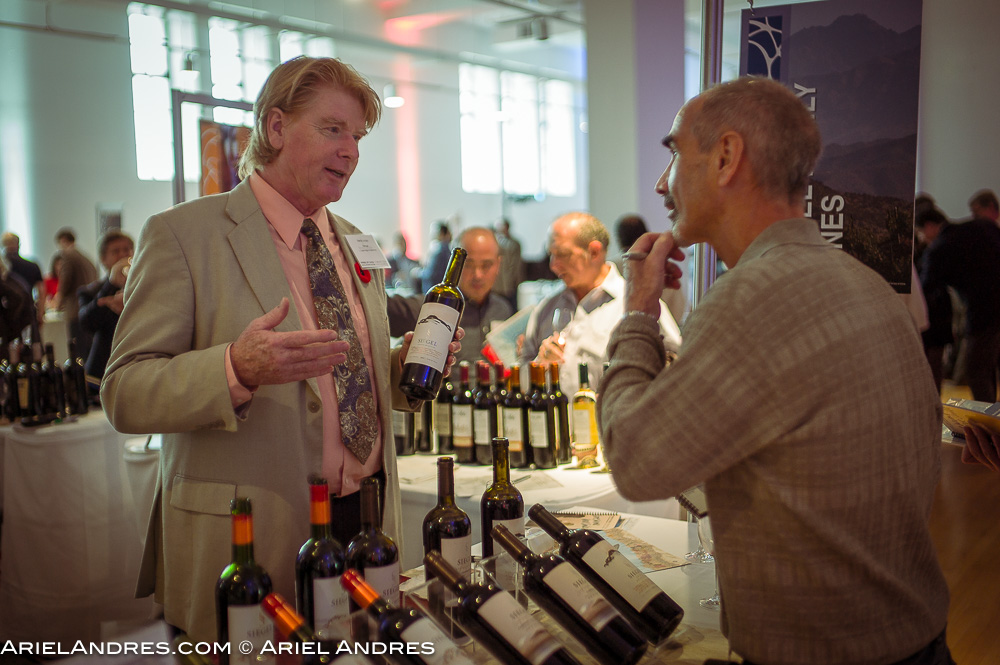 An agent discussing wine with a member of the trade at the Love Wine, Love Chile event at the Royal Ontario Museum in Toronto on Novembewr 1, 2016.